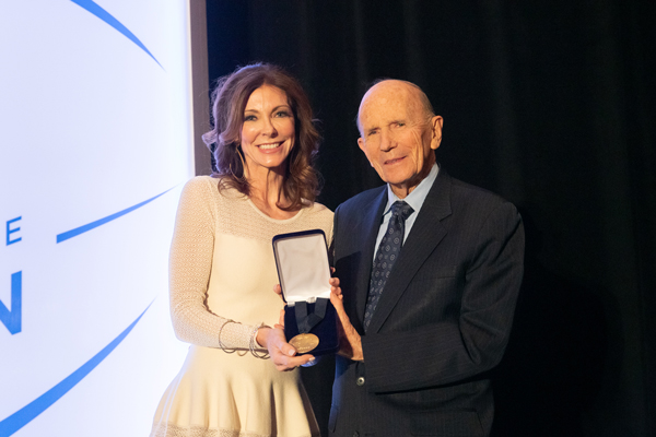 Kenneth H. Cooper presents the Legacy Award to Charlotte Jones Anderson in honor of the NFL Foundation